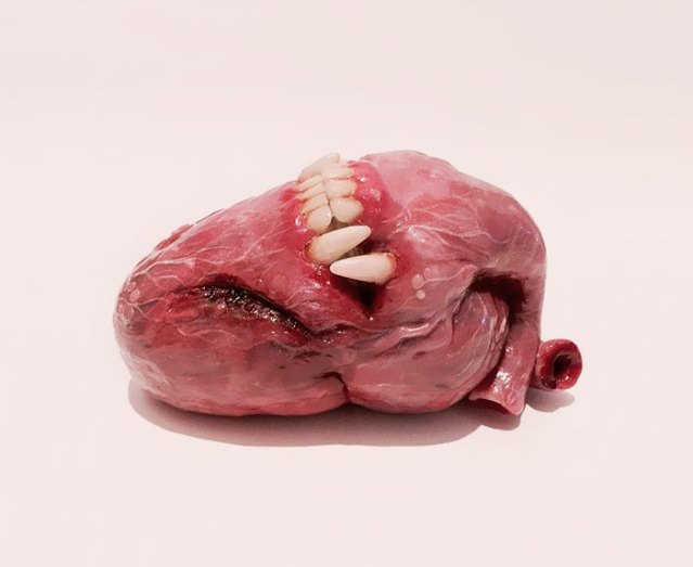 The-Scary-Baby-Carving-Sculptures-by-Artist-Qixuan-Lim-591a9e3813189__700