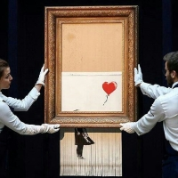 Banksy's self shredding art 'girl with the balloon' inspires funny internet parodies